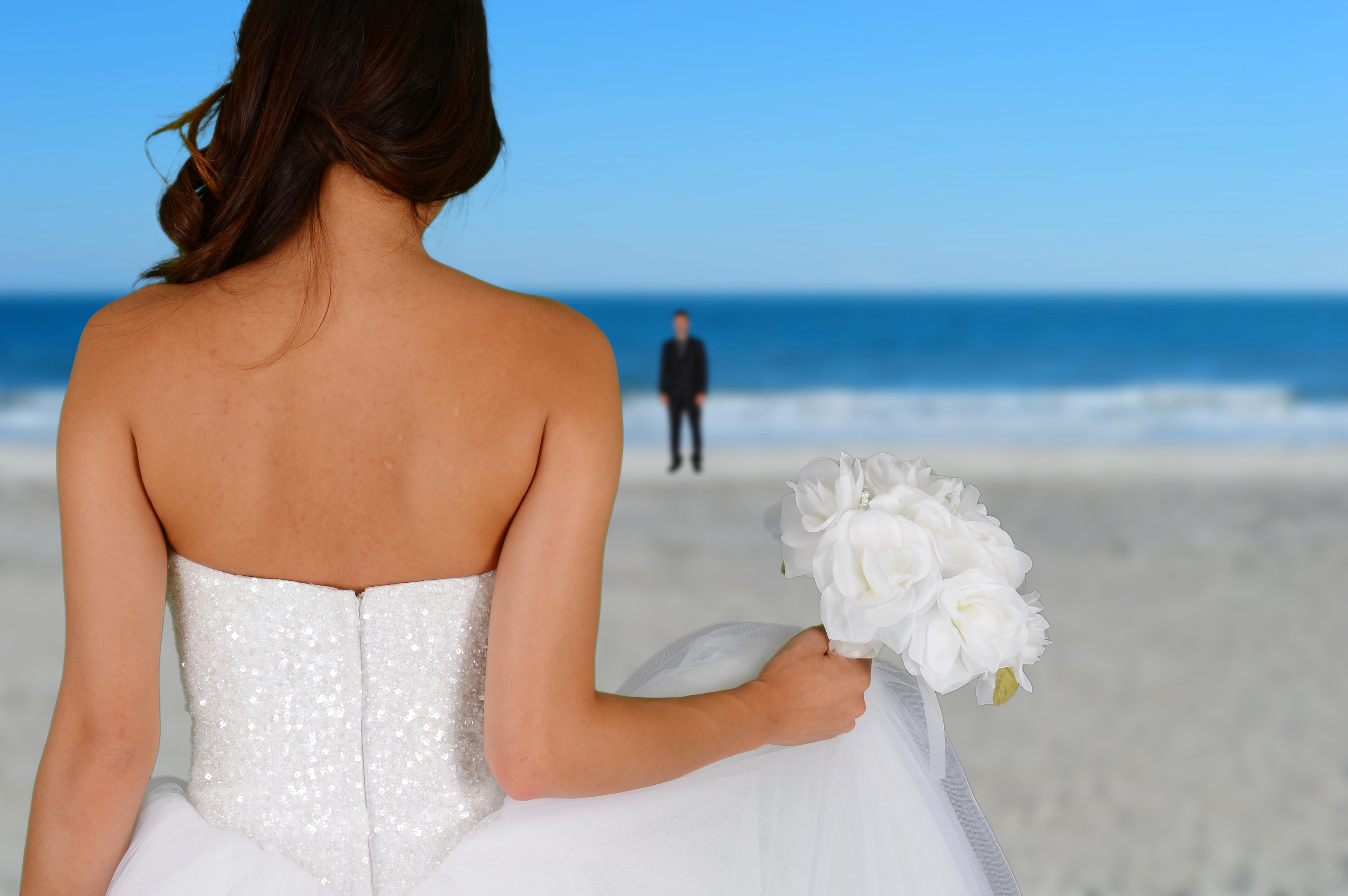 Woman in a beautiful white wedding dress with groom